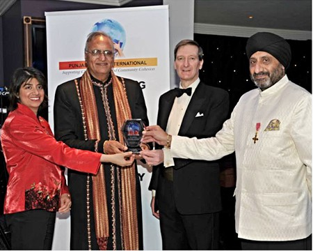 At the Punjabi Circle International UK Annual Awards in January 2014, Rahi Bains is being presented with an Award for Services to Punjabi Culture.