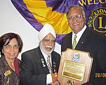"The President of The Lions Club of Osterley (London), Mr. Jagjit Singh Gill, awarding Rahi Bains with the ""Melvin Jojnes Fellow"" award in June 2013."