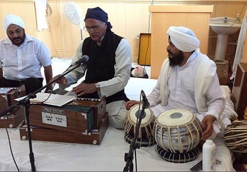 Getting ready to sing religious hymns at the Sikh Temple in Bristol