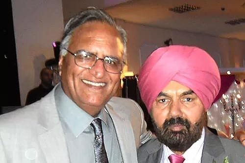 Rahi Bains and famous Punjabi folk singer A S Kang at Mr Kang's daughter's wedding, Midlands, UK